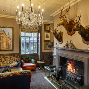 Lounge Fireplace Stags Rutland Arms Bakewell